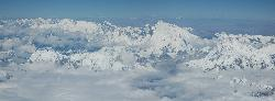 Approaching the Himalayas after half an hour in the air; Cho Oyo; Mount Everest; Lhotse; and Makalu are very close.
